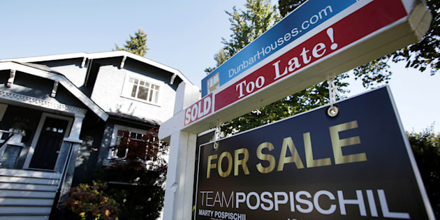 "A for sale sign is pictured in front of a home in Vancouver, B.C., Sept. 22, 2016. A proposal by Canada's banking regulator to expand ""stress tests"" for mortgage borrowers will reduce how much house Canadians can afford by 21 per cent, says a new report from mortgage comparison site Ratehub."