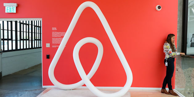 A woman talks on the phone at the Airbnb office headquarters in the SOMA district of San Francisco, California, Aug. 2, 2016.