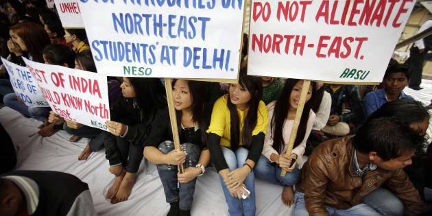 Members of North East Students Organization (NESO) hold placards as they participate in a protest in Gauhati.