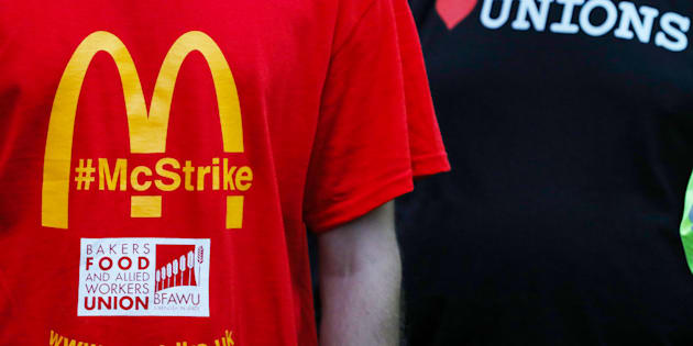 A member of staff wears a strike t-shirt as they listen to a speaker during a strike, the first industrial action by staff of the American fast-food chain in the U.K., outside a McDonald's Corp. fast-food restaurant in Cambridge, U.K., on Monday, Sept. 4, 2017. Workers at this restaurant, and one in Crayford, voted in favor of the strike following a dispute over the use of zero-hour contracts and the companys handling of internal grievances. Photographer: Chris Ratcliffe/Bloomberg via Getty Images