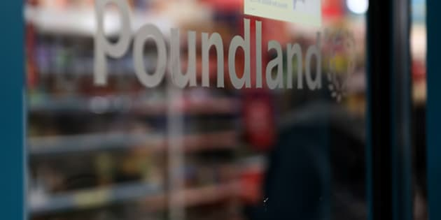 A Poundland logo sits at an entrance to a Poundland Group Ltd. discount retail store, operated by Steinhoff International Holdings.
