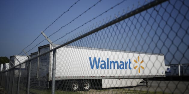 Tractor trailers sit parked outside a Wal-Mart Stores Inc. distribution center in Bentonville, Ark., Wed. July 29, 2015. Walmart Canada says it is starting to roll out one-hour grocery delivery today for customers in parts of the Greater Toronto Area.