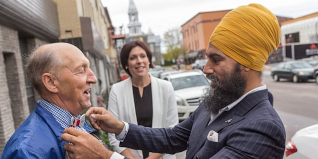 NDP Leader Jagmeet Singh talks with a passerby as he visits Alma in the riding of Lac St-Jean on Oct. 10, 2017.