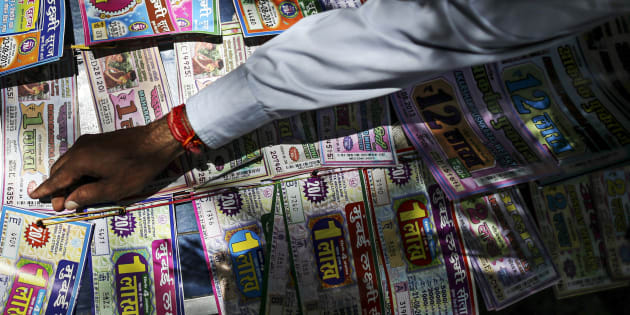 A roadside vendor arranges lottery tickets in Mumbai, India, on Wednesday, Aug. 21, 2013.