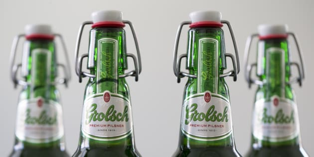 Swing top lids sit on Grolsch beer bottles, produced by SABMiller Plc, in this arranged photo in Utrecht, Netherlands, on May 1, 2016.