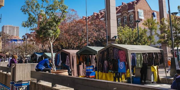 Vendors sell goods from gazebo covered stalls at a street market in the Central Business District [CBD] in Pretoria, South Africa.