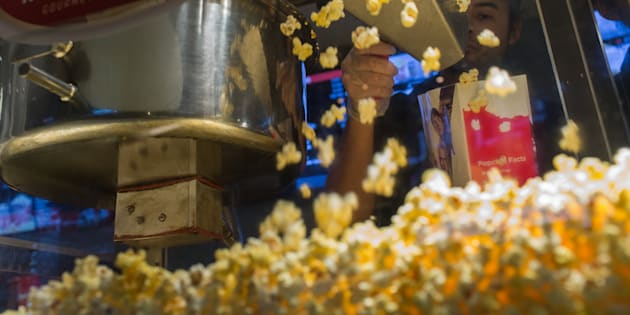 A worker scoops popcorn at a concession stand inside a Cinemark Holdings Inc. movie theater in the Playa Vista neighborhood of Los Angeles on Oct. 31, 2017.