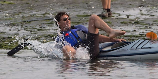 Prime Minister Justin Trudeau falls into the water while trying to get into a kayak at Sidney Spit in the Gulf Islands National Park Reserve, east of Sidney, B.C., on Saturday August 5, 2017.