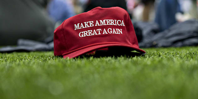 A 'Make America Great Again' hat sits on the ground ahead of a speech by U.S. President Donald Trump during a rally in Michigan, on April 28, 2018.
