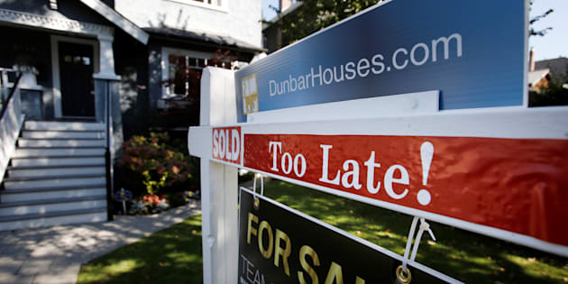 A real estate for sale sign is pictured in front of a home in Vancouver Sept. 22, 2016.