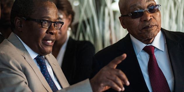 Brian Molefe, left, shows Jacob Zuma, South Africa's president, around the headquarters of Eskom Holdings.
