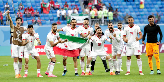 Soccer Football - World Cup - Group B - Morocco vs Iran - Saint Petersburg Stadium, Saint Petersburg, Russia - June 15, 2018   Iran players celebrate after the match    REUTERS/Henry Romero