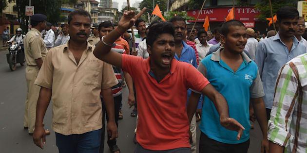 Indian members of the Maratha community in the state of Maharashtra shout slogans during a protest in Mumbai on July 25, 2018.