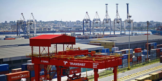 A crane operator unloads shipping containers from freight wagons at the Port of Durban, operated by Transnet SOC Holdings Ltd.'s Ports Authority, in Durban, South Africa, on Wednesday, Oct. 28, 2015.