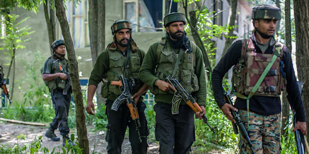 SAIMOH, KASHMIR, INDIA - MAY 27: Indian army troopers guard the area where top rebel commander of Hizbul Mujahideen Sabzar Ahmed , along with his associates Faizan Muzaffar, was taking refuge during a gun battle between Indian government forces and Kashmiri rebels on  May 27, 2017 in  Saimoh 45 km (28 miles) south of Srinagar, the summer capital of Indian  administered Kashmir, India.