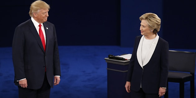 Donald Trump, 2016 Republican presidential nominee, and Hillary Clinton, 2016 Democratic presidential nominee, arrive on stage during the second U.S. presidential debate at Washington University in St. Louis, Missouri, U.S., on Sunday, Oct. 9, 2016. As has become tradition, the second debate will resemble a town hall meeting, with the candidates free to sit or roam the stage instead of standing behind podiums, while members of the audience -- uncommitted voters, screened by the Gallup Organization -- will ask half the questions. Photographer: Andrew Harrer/Bloomberg via Getty Images