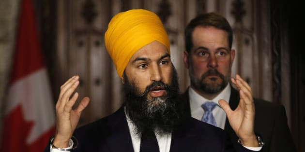 NDP leader Jagmeet Singh speaks to reporters with NDP environment critic Alexandre Boulerice on Parliament Hill in Ottawa on April 11, 2018.