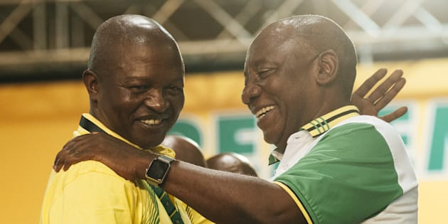 Cyril Ramaphosa, South Africa's deputy president and newly elected president of the African National Congress party (ANC), right, embraces David Mabuza, on Monday, Dec. 18, 2017.