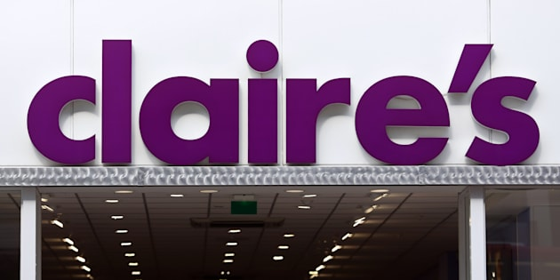A Claire's logo sits on display above the entrance to a Claire's Accessories store in London.