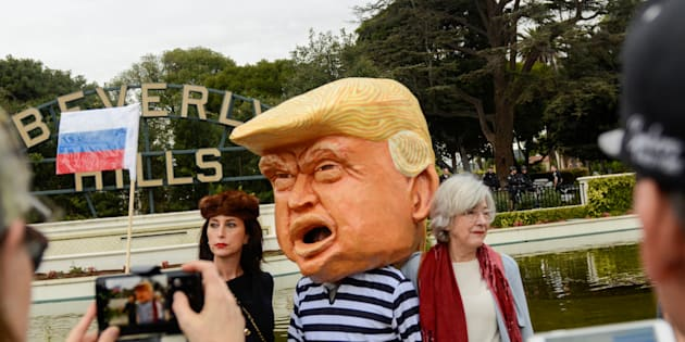 People protest at a park a few miles from a gated community where U.S. President Donald Trump is holding a fundraiser in Beverly Hills, California, U.S. March 13, 2018. REUTERS/Andrew Cullen