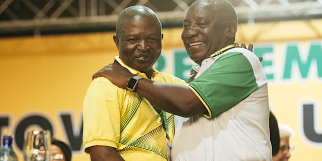 Cyril Ramaphosa, South Africa's deputy president and newly elected president of the ANC, right, embraces David Mabuza, newly appointed deputy president of the ANC