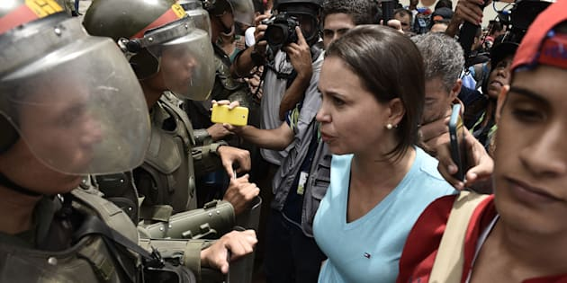 Protesters confront Venezuelan National Police officers during a demonstration for a referendum on the rule of President Nicolás Maduro in Caracas, Venezuela, on May 18, 2016.