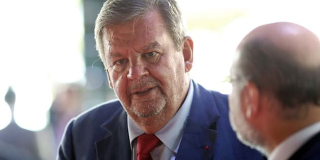 Billlionaire Johann Rupert, founder and chairperson of Compagnie Financière Richemont SA, speaks with delegates during the Business of Luxury summit in Monaco, on Monday, June 8, 2015.