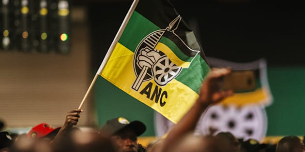 A delegate waves an ANC flag during a speech by Jacob Zuma, South Africa's president, not pictured, at the 54th national conference of the African National Congress party (ANC) in Johannesburg, South Africa, on Saturday, Dec. 16, 2017.