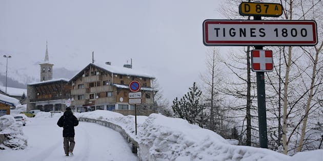 A road sign is seen on the side of a mountain road after a snow fall in Tignes on January 15 this year