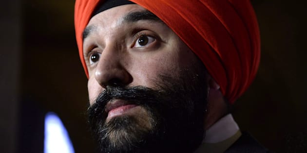 Minister of Innovation, Science and Economic Development Navdeep Bains listens to a question during a press conference on Parliament Hill in Ottawa, Mon. Nov. 26, 2018.
