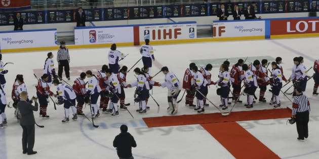 In this April 6, 2017 file photo, South, wearing white uniforms, and North Korean players shake hands after their IIHF Ice Hockey Women's World Championship Division II Group A game in Gangneung, South Korea.