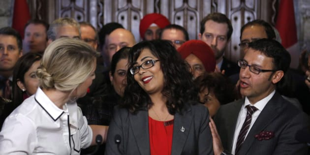 Liberal MP Iqra Khalid is congratulated by colleagues as she makes an announcement about an anti-Islamophobia motion on Parliament Hill on Feb. 15, 2017.