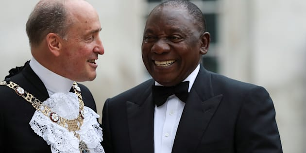 President Cyril Ramaphosa greets the Lord Mayor of London Charles Bowman as he arrives to attend the Commonwealth Business Forum Banquet at the Guildhall in London, Britain, April 17, 2018.