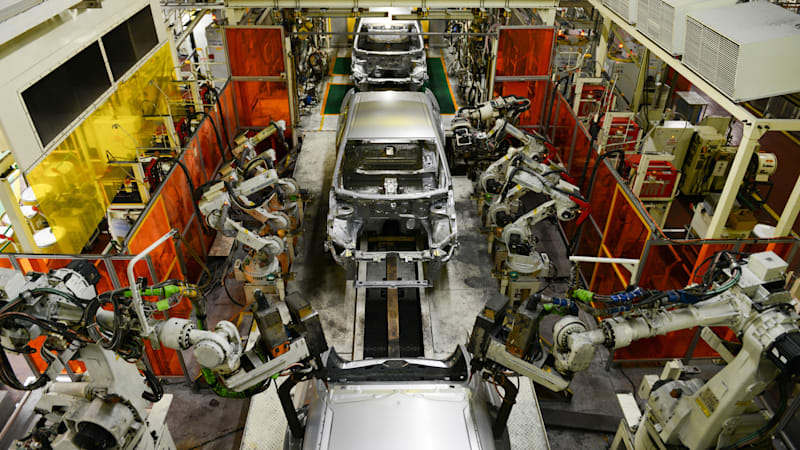 robotic-arms-weld-automobile-body-frames