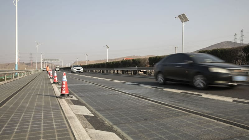 photo image China's solar road will charge cars as they drive