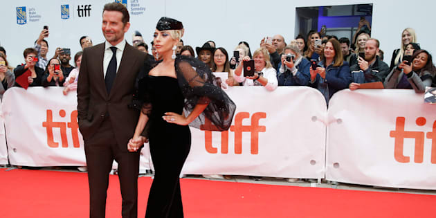 "Bradley Cooper poses with Lady Gaga at the world premiere of ""A Star is Born"" at the 2018 Toronto International Film Festival on September 9, 2018."