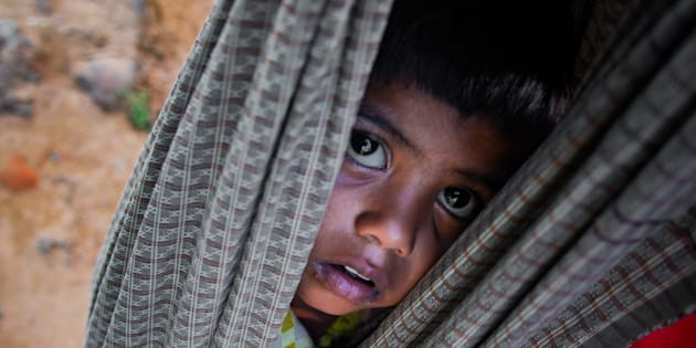 COXS BAZAR, BANGLADESH  OCTOBER 11: 4-year-old Rohingya kid Shehna starts journey from Myanmar on the shoulder of his father, to the refugee camp at Balukhali in Coxs Bazar, Bangladesh on October 11, 2017. (Photo by Stringer/Anadolu Agency/Getty Images)