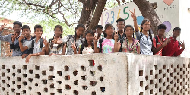 JAIPUR, INDIA- JULY 5: (Editors Note: The faces of children has been blured to protect identity) Students of the school at the Jhalana slum, who successfully opposed child marriage of their classmate, raise a victory sign on July 5, 2017 in Jaipur, India. (Photo by Himanshu Vyas/Hindustan Times via Getty Images)