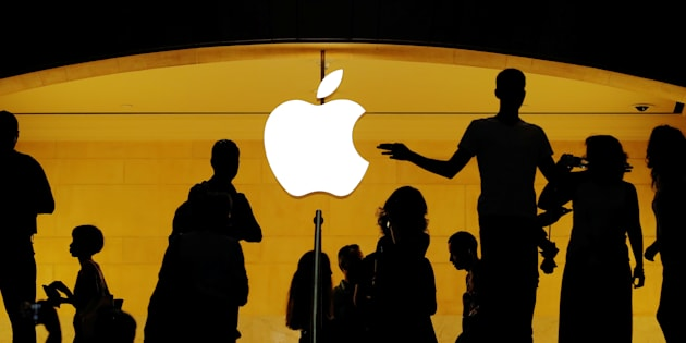 Customers walk past an Apple logo inside an Apple store at Grand Central Station, New York, N.Y., Aug. 1. Apple Inc. became the first US$1 trillion publicly listed company on Thursday.