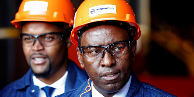 Mineral Resources Minister Mosebenzi Zwane (R) looks on during the reopening of the Highveld Steel heavy structural mill at Emalahleni in Mpumalanga province, South Africa June 6, 2017.