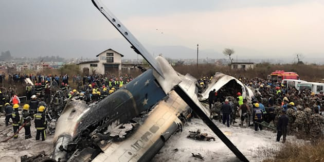 Wreckage of an airplane is pictured as rescue workers operate at Kathmandu airport, Nepal March 12, 2018. REUTERS/ Navesh Chitrakar     TPX IMAGES OF THE DAY