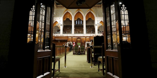 Pages and staff prepare the House of Commons on Parliament Hill on Dec. 2, 2015.