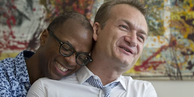 Clay Hamilton, left, and Adrian Coman, a US-Romanian gay couple who got married in Belgium and seek legal recognition of their status in Romania speak during an interview with the Associated Press in Bucharest, Romania, Friday, July 22, 2016. Commentators predict the court, scheduled to rule Tuesday on the marriage of U.S. graphic designer Claibourn Robert Hamilton and Romanian human rights activist Adrian Coman, will vote against the motion, amid opposition from the influential Romanian Orthodox Church and public disapproval of same-sex relationships.