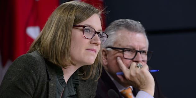 Democratic Institutions Minister Karina Gould attend a press conference with Public Safety Minister Ralph Goodale in Ottawa on Jan. 30, 2019.