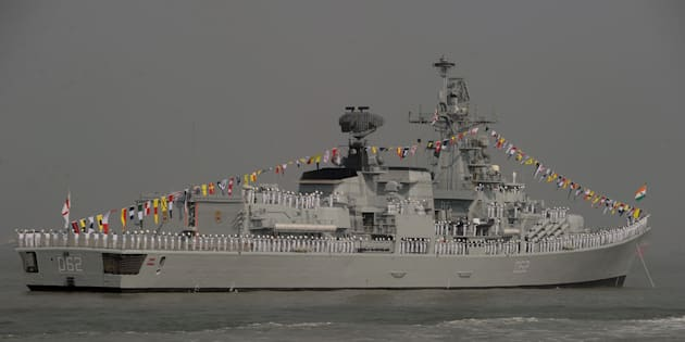 Indian Naval sailors stand on the deck of INS Mumbai.