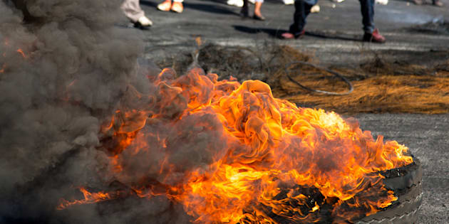 Protesters against the government burning rubber tyres in the streets in South Africa.