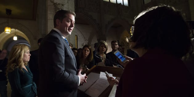 Tory Leader Andrew Scheer speaks with reporters as Conservative MP Michelle Rempel (left) looks on following Question Period in Ottawa on Dec. 4, 2018.