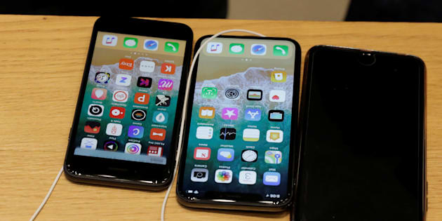 An Apple iPhone X model (C) is seen next to older models of iPhone on a table at an Apple store in New York, Nov. 3, 2017.