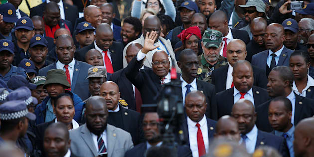 Jacob Zuma waves to supporters outside the High Court in Durban, June 8 2018.