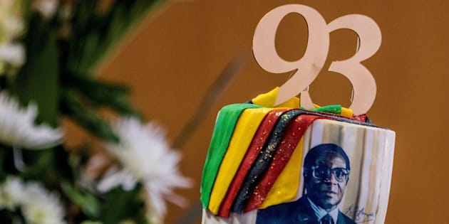 A picture taken on February 21, 2017 shows a cake bearing a portrait of Zimbabwe's President Robert Mugabe during a private ceremony to celebrate Mugabe's 93rd birthday in Harare.    Mugabe, the world's oldest national ruler, turned 93, using a long and occasionally rambling interview to vow to remain in power despite growing signs of frailty. / AFP / Jekesai NJIKIZANA        (Photo credit should read JEKESAI NJIKIZANA/AFP/Getty Images)